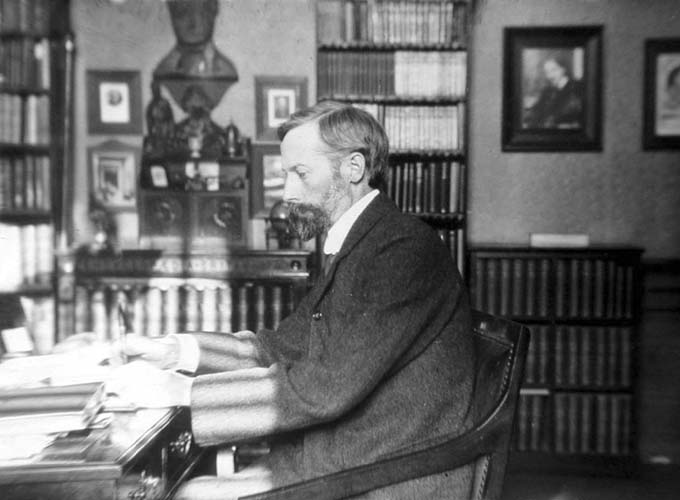 John George Bartholomew at his desk (1860-1920)